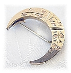Click here to enlarge image and see more about item 1107200426: Victorian Pinchbeck Half Moon Brooch