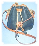 Click here to enlarge image and see more about item 1115200508: BLACK AND TAN LEATHER DOONEY AND BOURKE BAG..