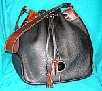 Click to view larger image of Dooney and Bourke Black  Tan Leather Bucket bag (Image1)