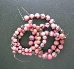 Click here to enlarge image and see more about item 11162009174: Rhodocrosite Pink Black Beads Unstrung