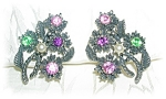 CRYSTAL  AND PEARL CORO CLIP EARRINGS .....