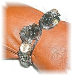 Click here to enlarge image and see more about item 1205200509: Silver CrystalPlastic/Lucite Clamper Bracelet