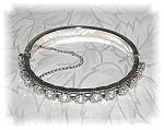 Click here to enlarge image and see more about item 1205200510: Silvertone Rhinestone Bangle Bracelet