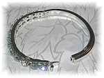 Click here to enlarge image and see more about item 1205200514: Silvertone Crystal Rhinestone Bangle Bracelet
