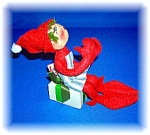 Click to view larger image of Annalee Christmas Cook Elf Sitting on a Present 1991 (Image1)