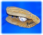 AUTOGRAPHED FRANKLIN BASEBALL GLOVE . . . .