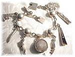 Click here to enlarge image and see more about item B626200713:  Bracelet Sterling Silver Mexican 9 Charm YM