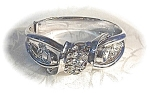 Click here to enlarge image and see more about item 717200326: TRIFARI Rhinestone Pull Apart Bangle Bracelet