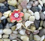 Click here to enlarge image and see more about item 87200942a: NOLAN MILLER Crystal  and Enamelled Flower  Brooch