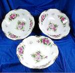 China floral bowls with gold trim and roses