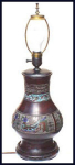 Click here to enlarge image and see more about item A021: Champlev�  lamp (19th century)