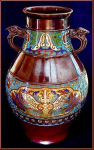 Click here to enlarge image and see more about item B035: Champlevé double-handled urn/vase (19th c.)