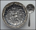 Click here to enlarge image and see more about item L072: Sterling silver repousse bowl and matching spoon (Kirk)