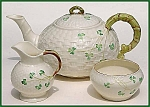 Click here to enlarge image and see more about item M005: Irish Belleek Shamrock on Basketweave teaset