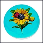 Ken Rosenfeld 2007: Ladybug on sunflower paperweight