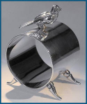 Click here to enlarge image and see more about item Z493: Vintage Sterling Silver figural napkin ring