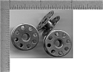 Click here to enlarge image and see more about item 12139: 3 Singer sewing machine bobbins fit model 221 and 301