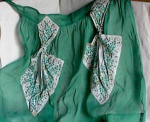 Click here to enlarge image and see more about item 1744: VINTAGE GREEN HANKY APRON