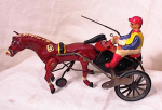 Click here to enlarge image and see more about item 2264: GERMAN TIN & COMPO WIND UP SULKY RACER