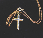 Click here to enlarge image and see more about item 2468: GOLD TONE CROSS WITH BLUE STONES
