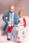 "Click here to enlarge image and see more about item 2819: MIOJ 3"" COLONIAL COUPLE WITH FLOWERS"