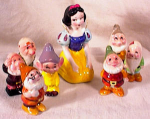 Click to view larger image of SNOW WHITE & SEVEN DWARFS PORCELAIN FIGURINE (Image1)
