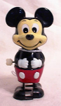 Click here to enlarge image and see more about item 371: WHITE KNOB MICKEY MOUSE WIND UP