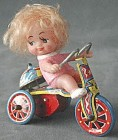 Tin Litho Windup Girl on Tricycle with Bell