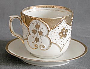 Antique Embossed White And Gold China Cup & Saucer
