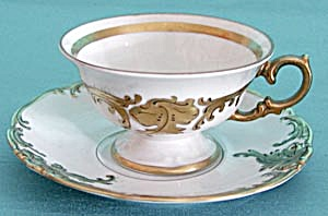 Vintage White With Raised Gold Design Cup & Saucer