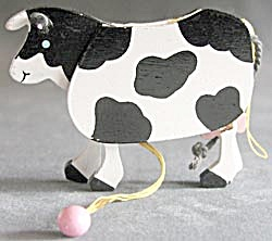 Wooden Moving Cow Christmas Ornament (Image1)