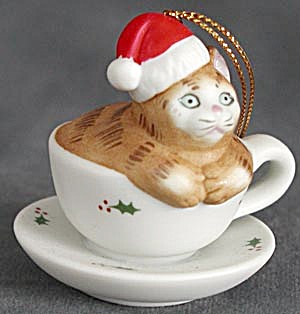 Brown Tabby Cat Sitting in a Holly Tea Cup Ornament (Image1)