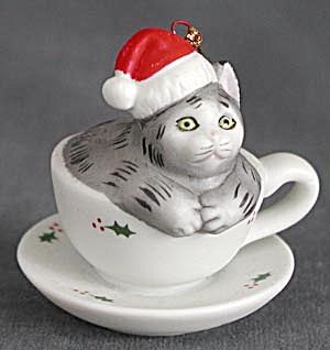 Gray Tabby Cat Sitting in a Holly Tea Cup Ornament (Image1)