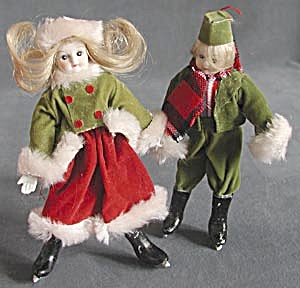Boy And Girl Skaters Christmas Ornaments