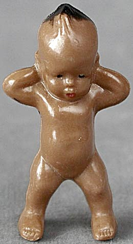 Vintage Brown Dollhouse Baby with a Mohawk (Image1)