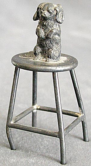 Vintage Metal Pekingese Sitting on a Stool Figurine (Image1)