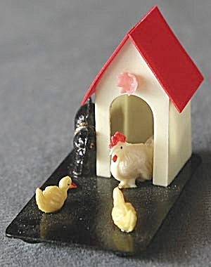 Vintage Celluloid Chickens & Cat On A Black Base