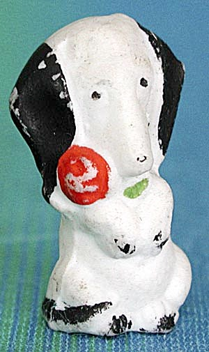 Vintage Bisque Dog Sitting Up Holding A Rose (Image1)