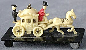 Vintage Celluloid Stagecoach on Black Base (Image1)