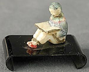 Vintage Celluloid China Man Reading on Black Base (Image1)