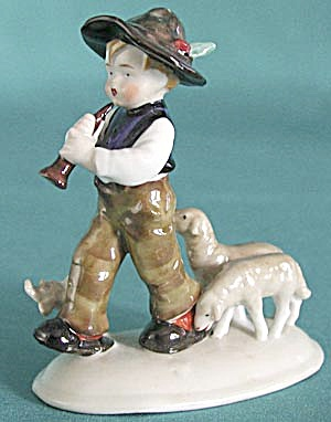 Vintage Boy Playing Horn and Lambs Following (Image1)