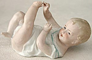 Vintage Heubach Piano Baby Playing With Toes (Image1)