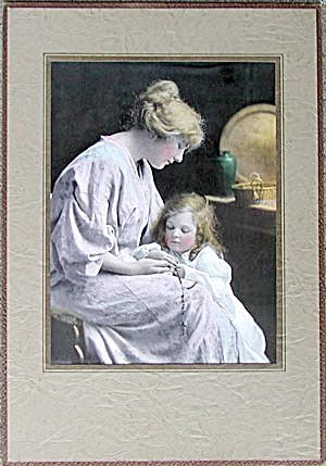 Mother and Daughter Praying the Rosary (Image1)