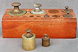 Vintage Brass Weights In Wooden Holder