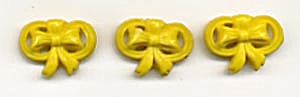 Vintage Yellow Bows Molded Plastic Buttons (Image1)