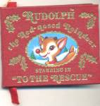 Click here to enlarge image and see more about item CAN60: Vintage Rudolpho To The Rescu Book Ornament
