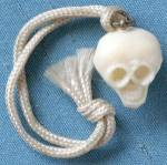 Click here to enlarge image and see more about item CHU15: Vintage Celluloid Skull Charm
