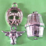 Click here to enlarge image and see more about item CHW8: Vintage Plastic Silver Charms Set of 3