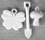 Click here to enlarge image and see more about item CO33: Vintage White Plastic Charms
