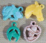Click here to enlarge image and see more about item CO45: Vintage Plasticl Charms Set of 4
